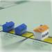 Verwenden Sie die Häuser und Hotels in Kombination mit einem normalen Monopoly-Spiel
